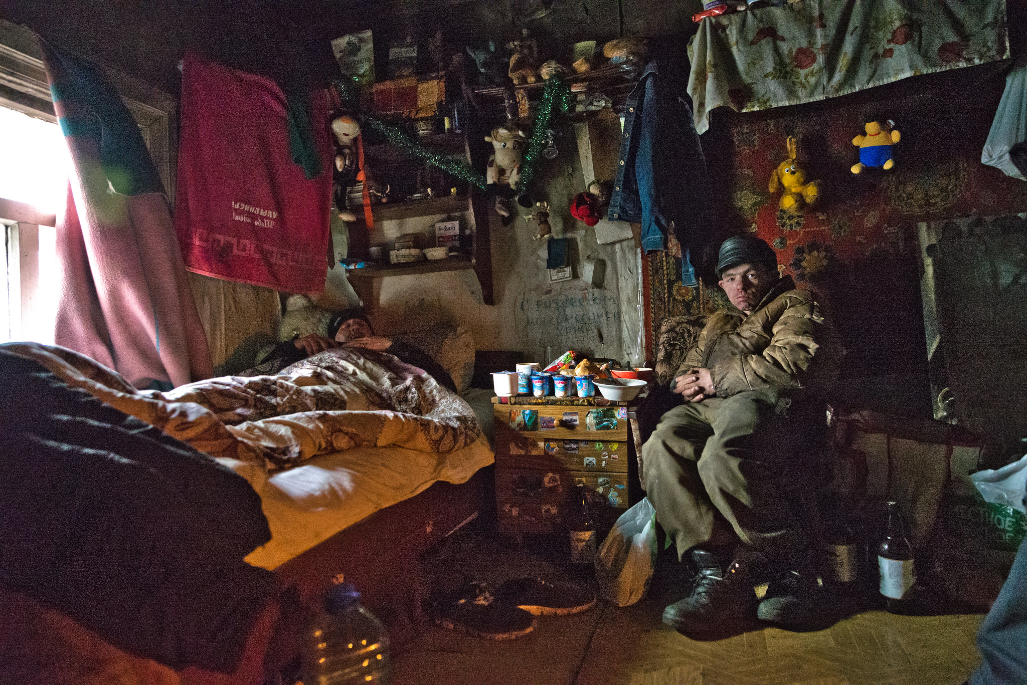 Homeless people living in an abandoned cottage in Minsk (Belarus)